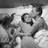 G.B. ENGLAND. Shepperton. Anne Bancroft, Peter Finch and the director Jack Clayton on the set of The Pumkin Eater. 1963.
