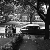 Family in front of car 1953