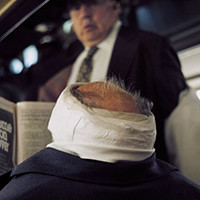 Man with bandaged head 1976
