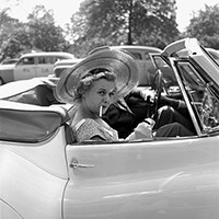 Woman in car with cigarette 1953