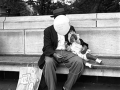 CENTRAL PARK, MAN WITH BABY AND BALLOONS, 12 X 12 IN (IMAGE), 20 X 16 IN (PAPER) MODERN GELATIN SILVER PRINT, LTD. ED. OF 15 0118639