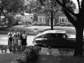 FAMILY IN FRONT OF CAR 1953, 12 X 12 IN (IMAGE), 20 X 16 IN (PAPER) MODERN GELATIN SILVER PRINT, LTD. ED. OF 15 0119801