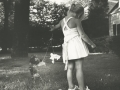 GIRL WITH CAT, CHICAGO 1960, 12 X 12 IN (IMAGE), 20 X 16 IN (PAPER) MODERN GELATIN SILVER PRINT, LTD. ED. OF 15 0117468