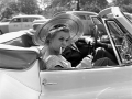 WOMAN IN CAR WITH CIGARETTE 1953, 12 X 12 IN (IMAGE), 20 X 16 IN (PAPER) MODERN GELATIN SILVER PRINT, LTD. ED. OF 15 0115819