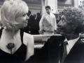 "Harpo Marx Gives Classic ""Watch-Out-Here-I-Come"" Leer to Model Marianne Meldow, NYC, 1961"